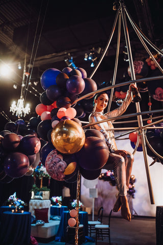 aerial bartender with hand painted balloons by revelry goods