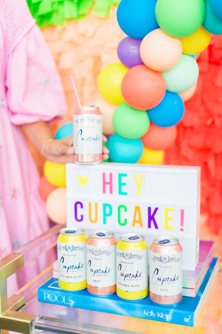 hey cupcake canned wine with fringe photo backdrop by revelry goods