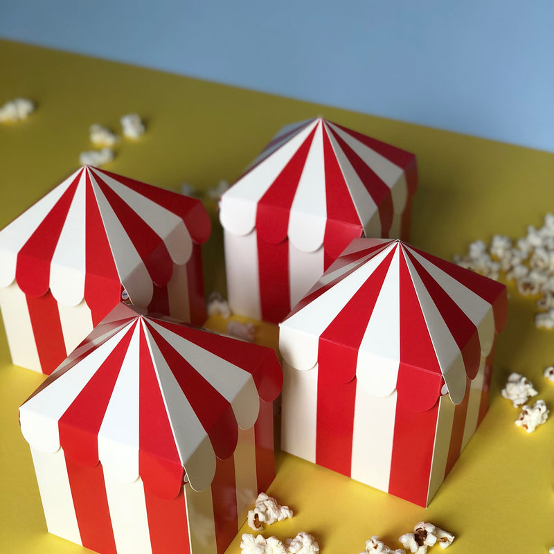Red and white striped carnival themed favor boxes with popcorn