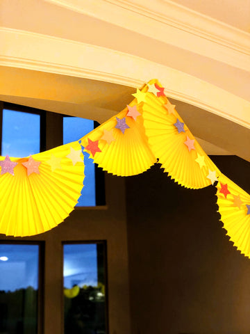 Yellow bunting fan garland with glitter star garland party decor | Revelry Goods