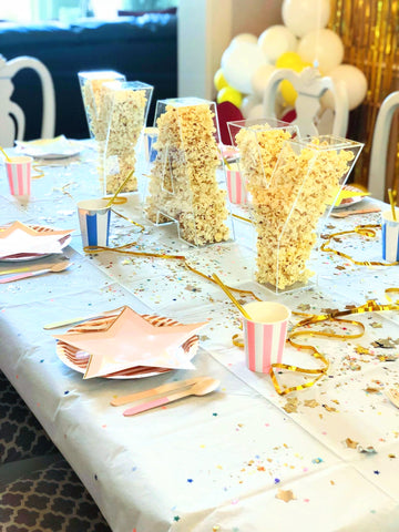 Movie themed party with star plates and popcorn decorations | Revelry Goods