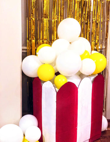 Giant DIY popcorn bag by Revelry Goods for a movie themed birthday party