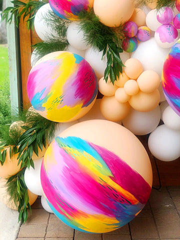 hand painted balloons in houston by revelry goods