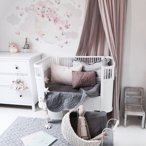 Calming nordic and Scandinavian nursery decor featuring elephant grey cot quilt by Bonne Mere
