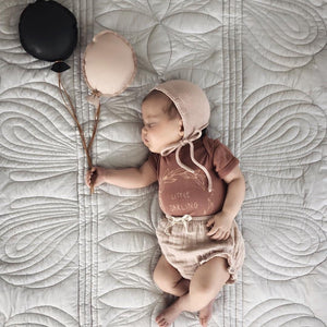 mist single quilt set draped over childrens bed