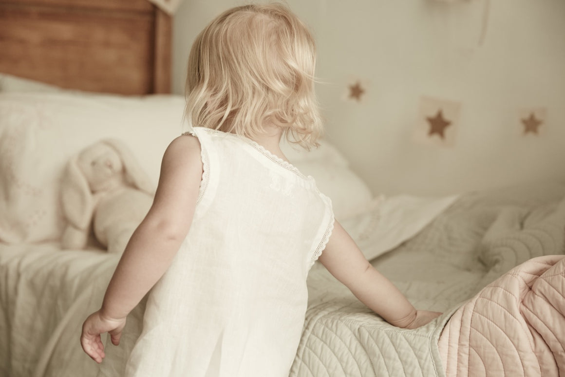 little girl wearing bonne mere white pure linen nightie dress
