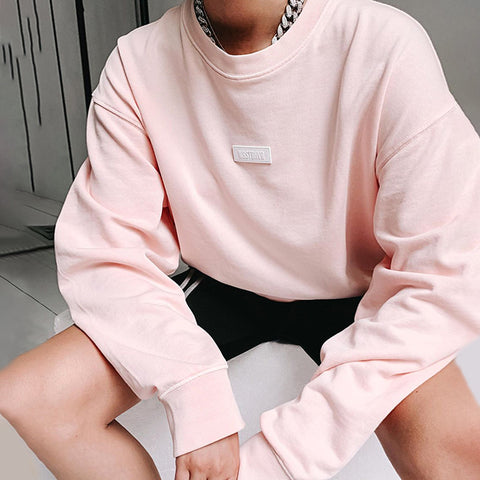 Solid color round collar long sleeved t-shirt
