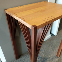 Close up of coffee table with unique arches joining the legs to the table top