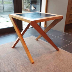Coffee table with slanted legs