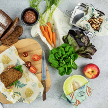 Picnic style lunch with food wrapped in organic beeswax wraps.