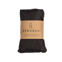 Photograph of reusable black grocery bag in pouch with cardboard sleeve
