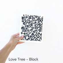 Dish cloth with black love tree design.