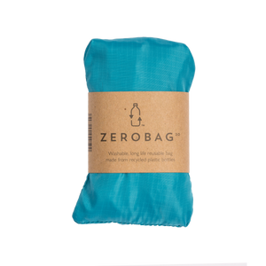 Photograph of reusable turquoise grocery bag in pouch with cardboard sleeve