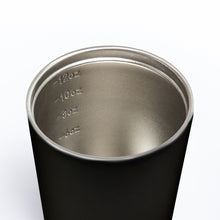 Internal view of reusable and insulated stainless steel coffee cup.