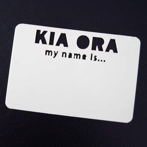 "White plastic reusable name tag with ""Kia ora my name is ..."" cut out of the plastic."