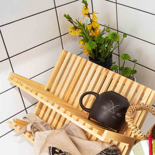 Wooden draining rack with flowers in a kitchen