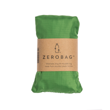 Photograph of reusable green grocery bag in pouch with cardboard sleeve