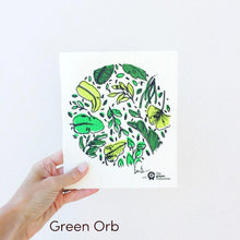Dish cloth with green orb design.