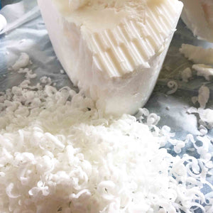Laundry soap which has been grated for use in laundry powder.