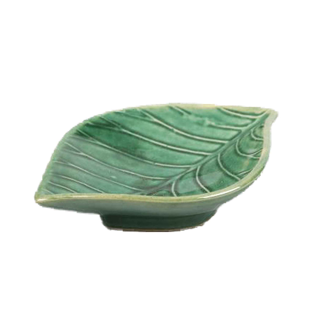 Green dish in the shape of a leaf.