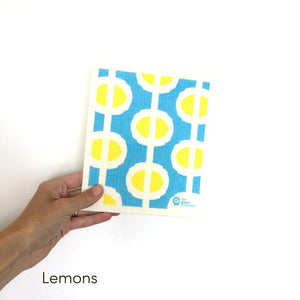 Dish cloth with abstract lemons on blue background design.