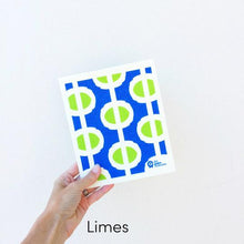Dish cloth with abstract limes on blue background design.