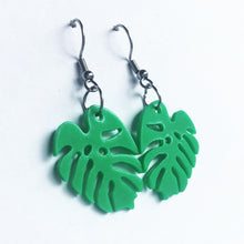 Bright green Monstera earrings made from 3D printer waste.