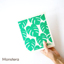 Dish cloth with large green monstera design.