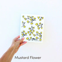 Dish cloth with mustard flower design.
