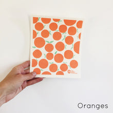 Dish cloth with oranges design.