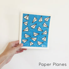 Dish cloth with paper planes design.