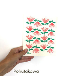 Dish cloth with red and green Pohutakawa flower design.