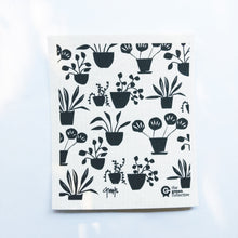 Dish cloth with black pot plants design.