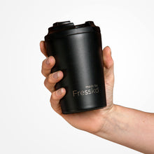 Reusable stainless steel coffee cup fits nicely in your hand.