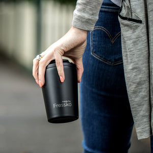 Reusable insulated stainless steel coffee cup.