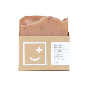 Rosehip Retreat - a pink rose coloured soap and body wash bar in minimal cardboard packaging.