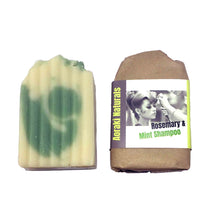 Rosemary and mint solid shampoo bar wrapped in brown paper packaging. Made in New Zealand.