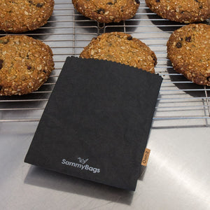 SammyBags Small flat reusable and washable black paper bag, with a tray of cookies.
