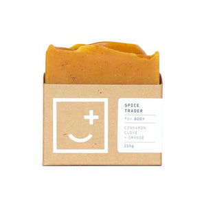 Spice Trader - orange coloured soap and body wash bar in minimal cardboard packaging.