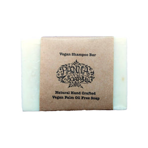 Solid vegan shampoo bar with minimal paper packaging.