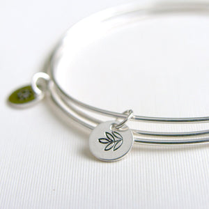 One Sterling Silver Bangle with Multi Leaf Stamped Charm
