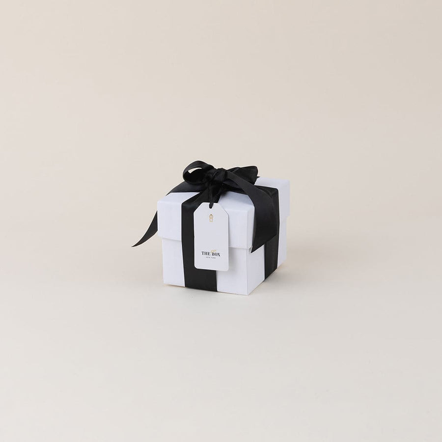 Dark Spaces Candle in Spruce & Amber; by Brand+Iron