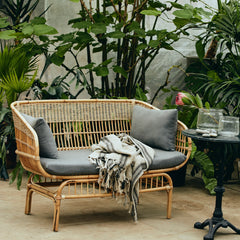 Rattan outdoor sofa with removable cushions