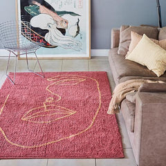 Rose gold rug with a gold line face outline