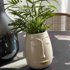 Cream face plant pot
