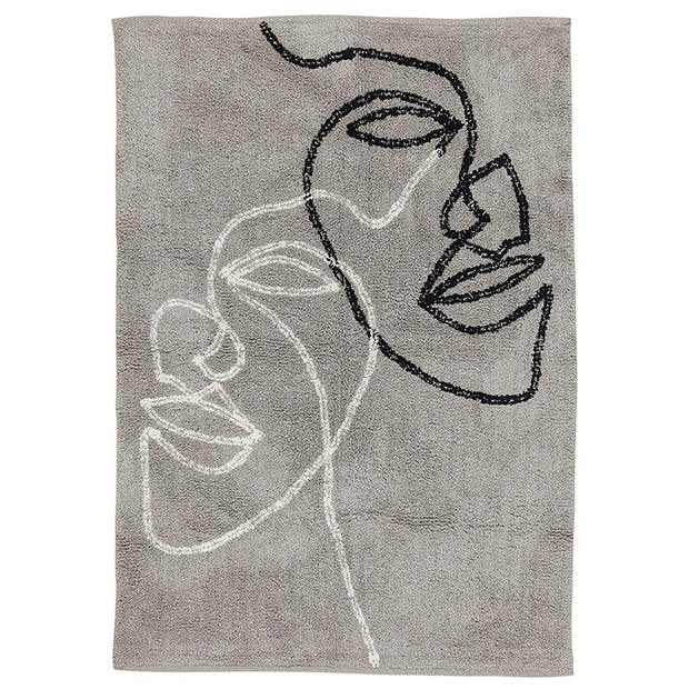 Sustainable beige rug made out of eco-friendly organic cotton with two black and white line drawing faces