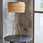 Three tiered gold silky fringe table lamp on a brass tripod base