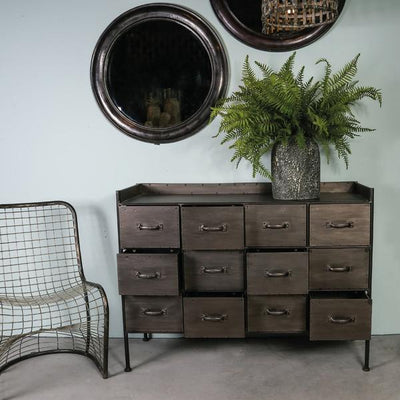 Metal apothecary cabinet with 12 individual drawers on three rows