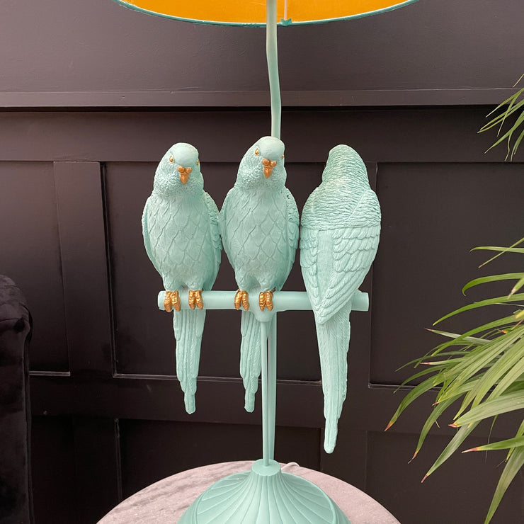 Turquoise blue parrot table lamp with three birds & a blue shade
