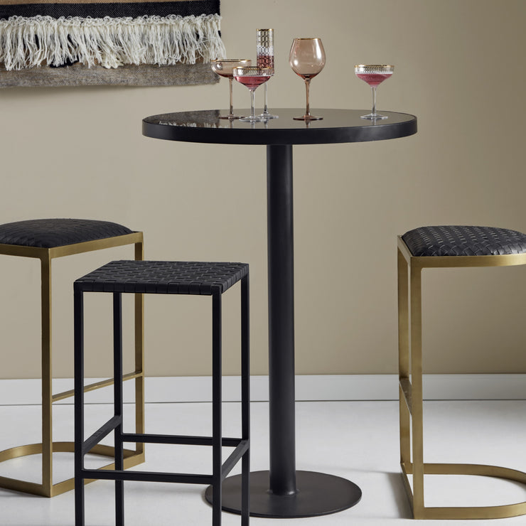 Round black glass bar table with a black iron base